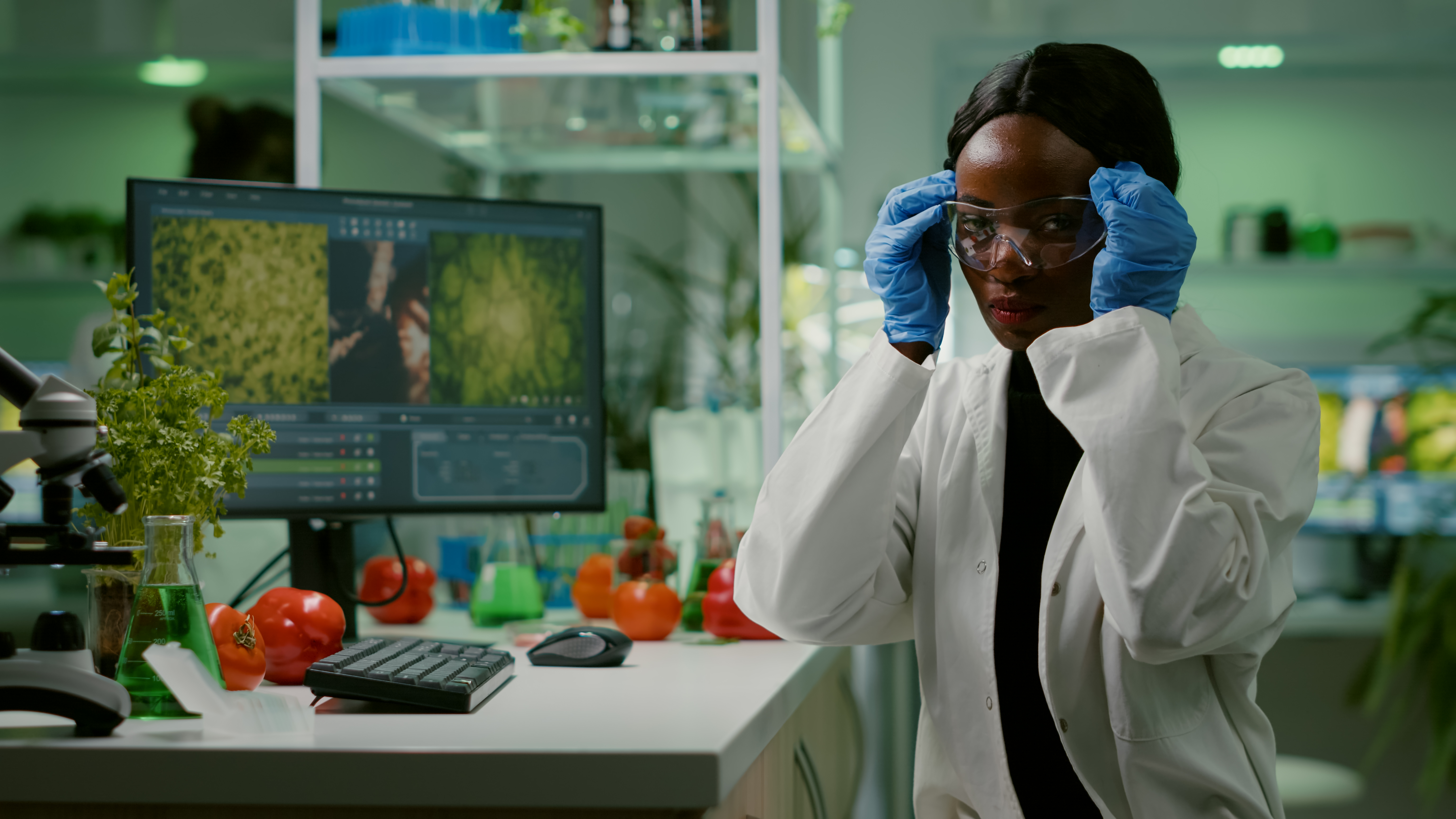 african-scientific-woman-putting-her-medical-glasses-looking-at-camera