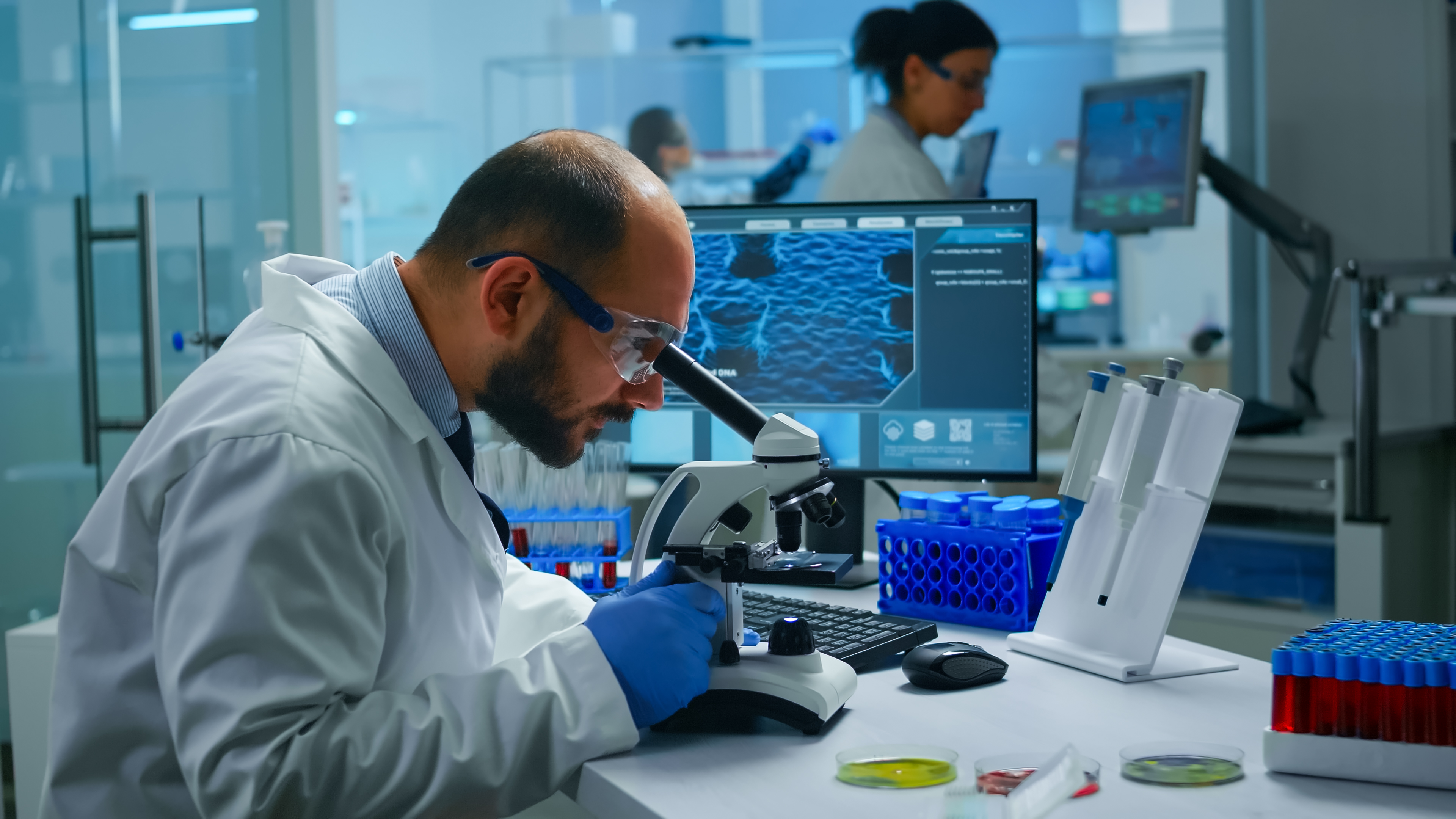 medical-research-scientist-conducting-vaccine-development-under-digital-microscope-in-a-biological-applied-science-laboratory